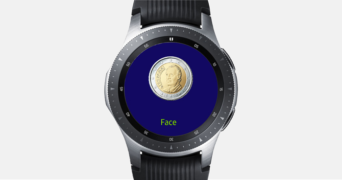 Screenshot of the Galaxy Watch with Toss app showing a Face of the coin with a blue background on the Watch Screen