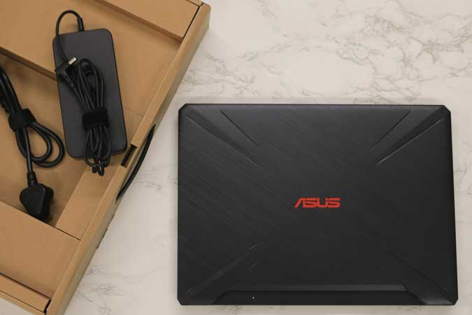 asus laptop with charging brick with box